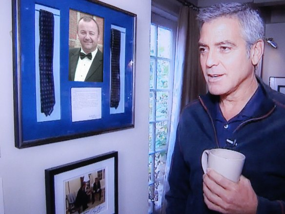 George admires his display of                                  Sharp Single Coffee Club ties.