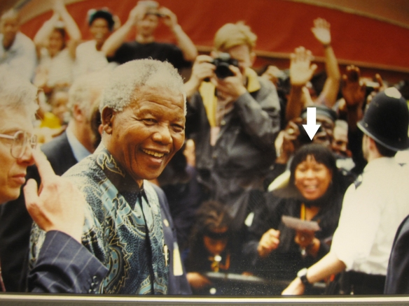Diane Abbott (arrow in head), having walked 17 miles to purely coincidentally bump into Madiba,  tries to accidentally get into the same frame as the Great Statesman. Outside Tooting Village Hall, 1994
