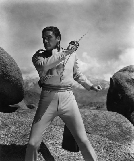 1936 : The Chargeof the Light Brigade.  Errol Flynn flashes not only his Sabre but also his avocado collection.