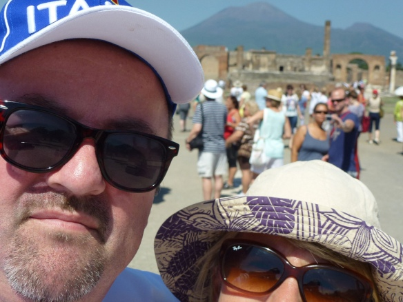 Proving that there should be an age-limit to prevent old people attempting selfies. That's Mt Vesuvius in the middle, no idea who the two people in the foreground are.